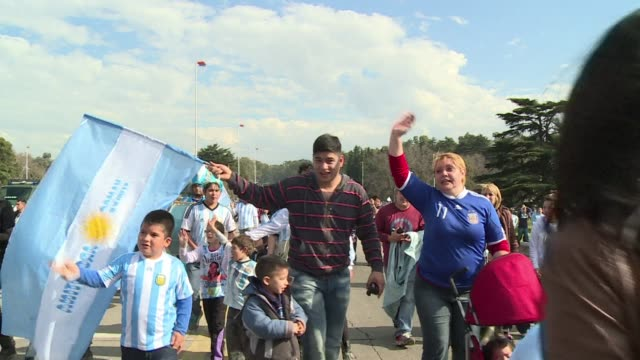 A crestfallen Lionel Messi kept a low profile as thousands of people greeted the Argentina squad on their return home Monday just hours after their...