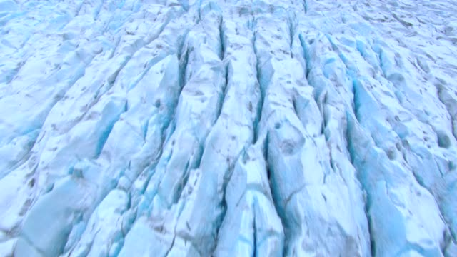crevasses cover a vast ice field. - ice floe stock videos & royalty-free footage