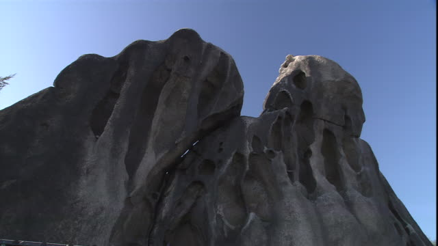 crevices are seen on the rock face of seonbawi rock. - rock face stock videos & royalty-free footage