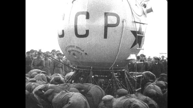 crew and ground crew of ussr1 work with equipment on the ground as the moored balloon stands in the background / vs the balloon with its auxiliary... - cyrillic script stock videos & royalty-free footage