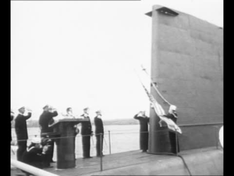 crew and officers of uss nautilus stand in formation on ship's deck during ceremony of its commission into the us navy / naval officials salute as... - groton connecticut stock videos & royalty-free footage