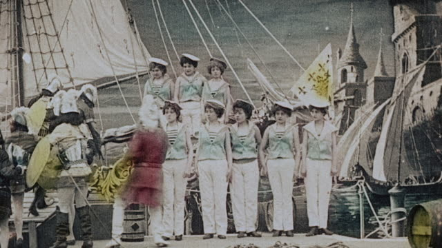stockvideo's en b-roll-footage met 1903 ws crew and the knights of a rescue party boarding a ship, leaving one elderly knight behind, during the film illusions, le royaume des fées (the kingdom of fairies) by georges melies - georges méliès