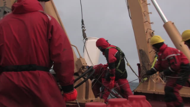 crew coordinates lowering equipment over the side of the ship in the arctic, september 18, 2008 – from the historic 17-month expedition involving 250... - lowering stock videos & royalty-free footage