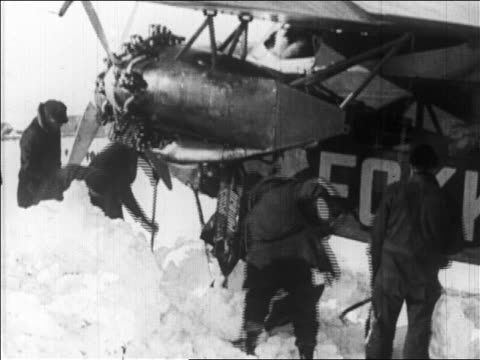 crew digging byrd's airplane from snowbank before flight over the north pole / newsreel - 1926 stock videos & royalty-free footage