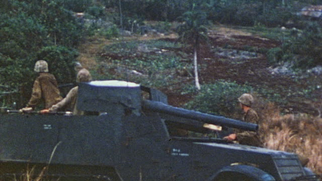 crew driving m7 priest in hilly country, and the barrel recoiling as it fires / saipan, mariana islands - 1944 stock videos & royalty-free footage