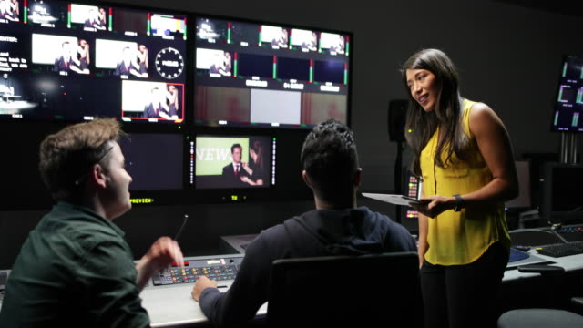 tv crew having meeting in control room - control room stock videos & royalty-free footage