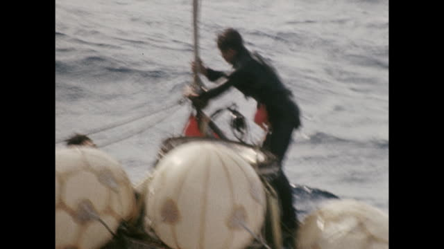 vídeos de stock e filmes b-roll de crew helps to retrieve the space capsule from the apollo 11 mission to the uss hornet.sp00251 ss rt: 7:57 wr 07-16-69 sil 35mm the launching of the... - prt