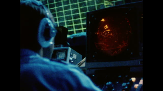 MONTAGE Crew in the control room checking radar and communicating with pilots after a successful mission / United Kingdom