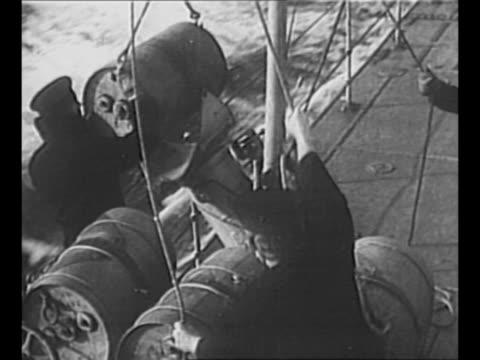 crew member looks through binoculars as canadian ship battles nazi u-boat during world war ii / montage ship fires guns / wake of ship / sailors... - convoy stock videos & royalty-free footage