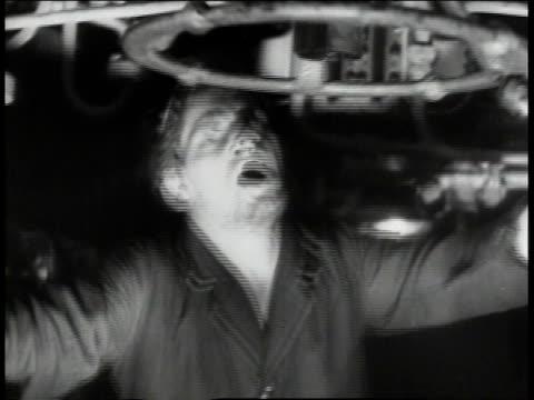 stockvideo's en b-roll-footage met crew member struggling to get hatch open men climbing ladder / - hatch