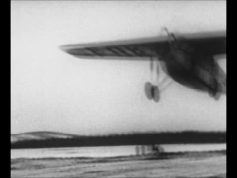 stockvideo's en b-roll-footage met crew member with explorer george h. wilkins's plane in fairbanks, ak / plane takes off / damaged plane with wheel off after test flight / byrd's ship... - pilot