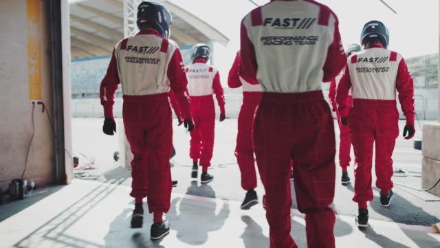 crew members in uniforms walking towards pit stop - pit stop stock videos & royalty-free footage