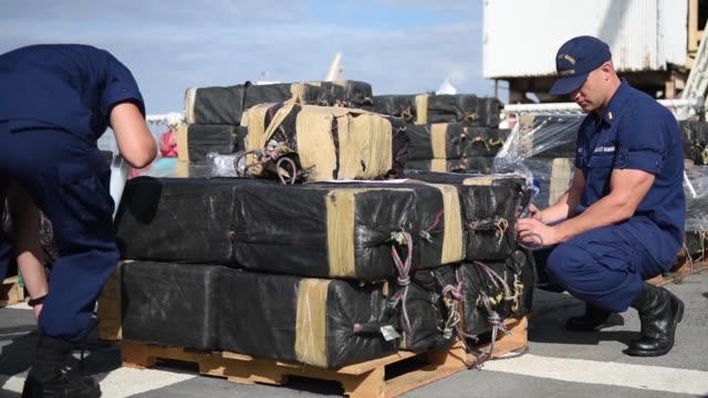 crew members of the coast guard cutter stratton offload 11 tons of cocaine in san diego, october 3 2018. the drugs were seized during the... - drug trafficking stock videos & royalty-free footage
