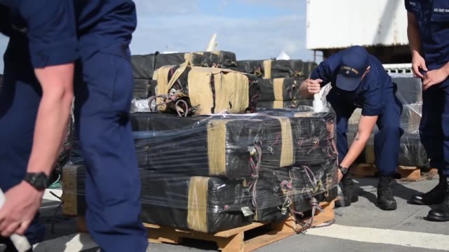 crew members of the coast guard cutter stratton offload 11 tons of cocaine in san diego october 3 2018 the drugs were seized during the interdiction... - 密輸点の映像素材/bロール