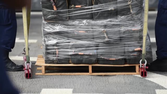Crew members of the Coast Guard Cutter Stratton offload 11 tons of cocaine in San Diego October 3 2018 The drugs were seized during the interdiction...