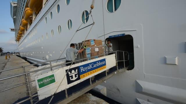 vídeos y material grabado en eventos de stock de crew members of the royal caribbean cruise ship mariner of the seas unload 20,000 meals and cases of bottled water for the victims of hurricane... - crucero vacaciones