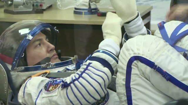 Crew members Russian Oleg Kononenko NASA astronaut Kjell Lindgren and Kimiya Yui of Japan underwent final tests Wednesday before their scheduled...