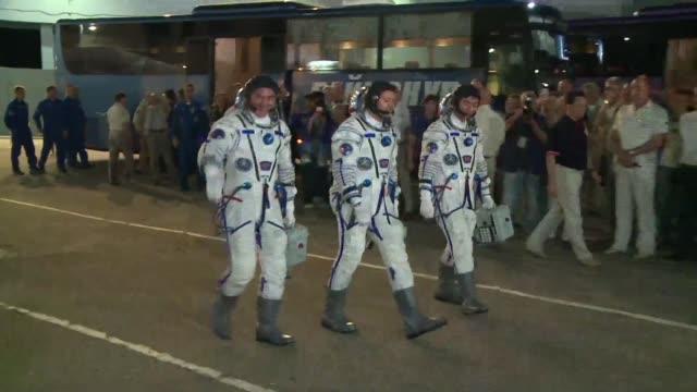 Crew members Russian Oleg Kononenko NASA astronaut Kjell Lindgren and Kimiya Yui of Japan on Wednesday prepared to blast off in a Soyez rocket...