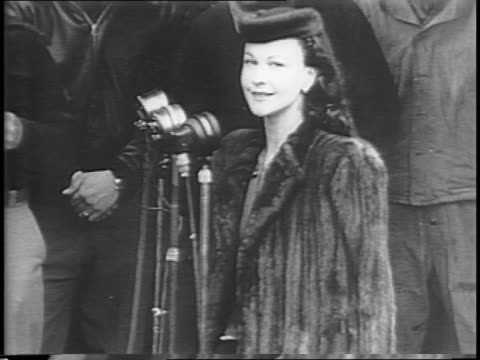 crew of b-17 flying fortress stands with plane in england / bomber is named 'stage door canteen' / laurence olivier and vivian leigh speak to troops... - bomber stock videos & royalty-free footage