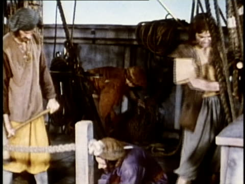 1948 reenactment montage crew of christopher columbus working on deck of ship, hammering, tying rope-lines and preparing for voyage / audio - equipaggio video stock e b–roll