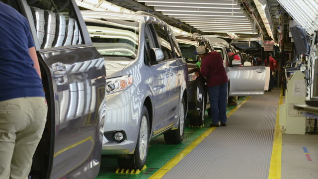 MS T/L Crew of workers inspect fully assembled mini vans / Princeton, Indiana, United States
