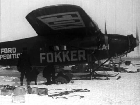 pan crew pushing admiral byrd's airplane before flight over north pole / newsreel - 1926 stock videos & royalty-free footage