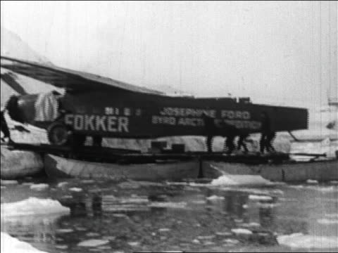 pan crew pushing aiplane for byrd's flight over the north pole onto land / newsreel - 1926 stock videos & royalty-free footage