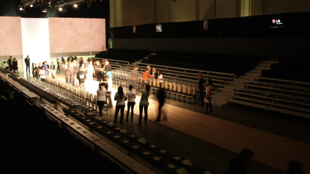 a crew sets up for a runway show in toronto, canada. - television show stock-videos und b-roll-filmmaterial