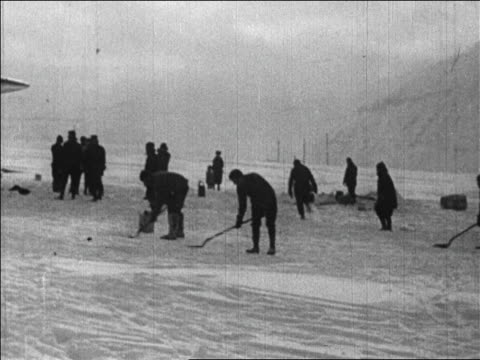 crew shoveling ice to prepare for byrd's flight over the north pole / newsreel - 1926 stock videos & royalty-free footage