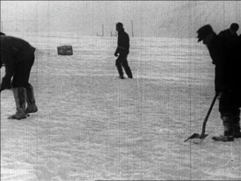 pan crew shoveling ice to prepare for byrd's flight over the north pole / newsreel - 1926 stock videos & royalty-free footage
