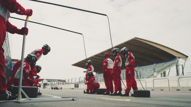 crew waiting at pit stop during motorsport event - pit stop stock videos & royalty-free footage