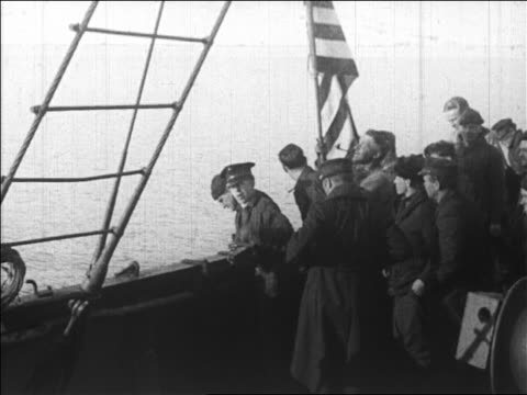 crew waving us flag on ship after byrd's flight over north pole / newsreel - 1926 stock videos & royalty-free footage