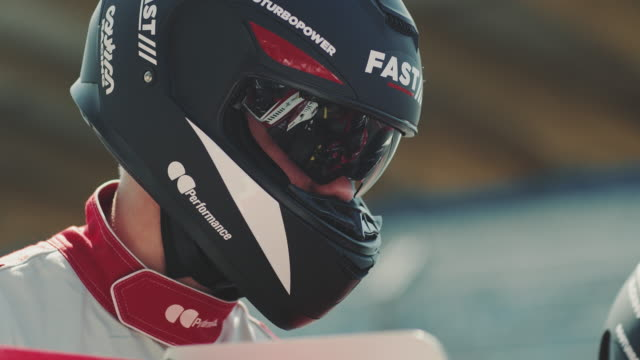 crew wearing crash helmets during sports race - crash helmet stock videos & royalty-free footage