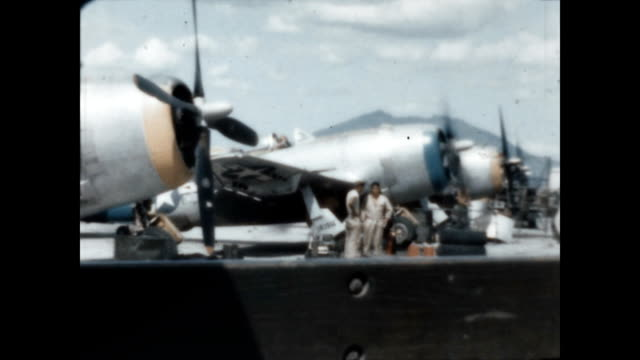 crew works on a p-51 mustang fighter plane at clark air base in wwii. - 1946 stock videos & royalty-free footage