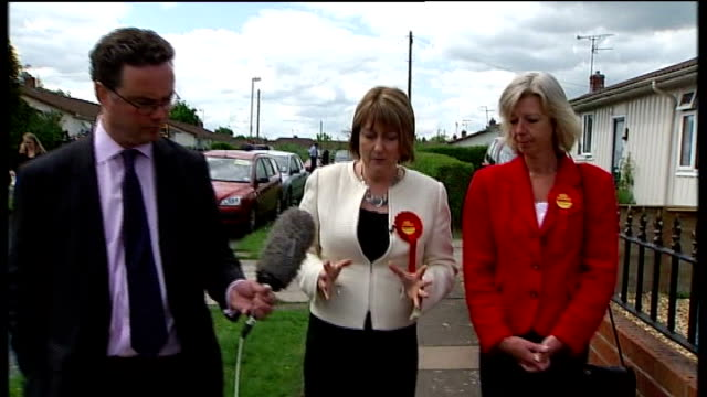 crewe and nantwich by-election: campaigning; ext jacqui smith mp speaking as walking with reporter and dunwoody sot - of course he is asset tamsin... - ナントウィッチ点の映像素材/bロール