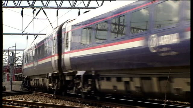 crewe and nantwich by-election: campaigning; int party workers in conservative hq ext back view train away along track conservative party worker... - ナントウィッチ点の映像素材/bロール