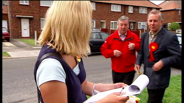 crewe and nantwich by-election: campaigning; tamsin dunwoody campaigning labour party activists in street with clipboard close shot labour campaign... - ナントウィッチ点の映像素材/bロール