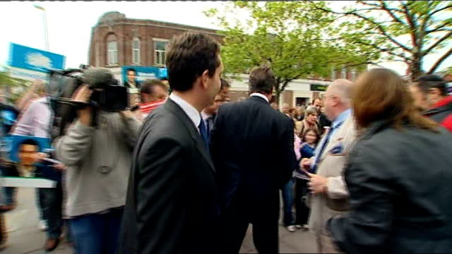 crewe and nantwich by-election: conservative victory; crewe: cameron and timpson greeting locals following election victory - nantwich stock-videos und b-roll-filmmaterial