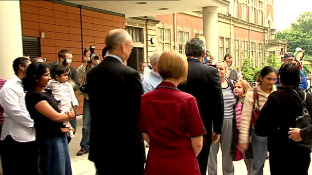 crewe and nantwich by-election: conservative victory; ext brown meeting people outside hospital - ナントウィッチ点の映像素材/bロール