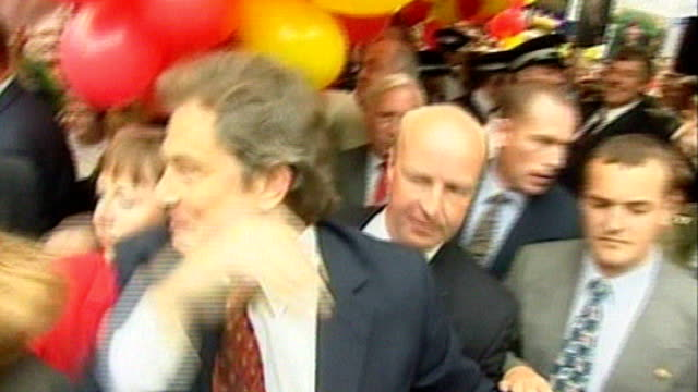 crewe and nantwich by-election: conservative victory; lib - 1997 merseyside: wirral south: tony blair mp celebrating by-election victory by labour... - ナントウィッチ点の映像素材/bロール