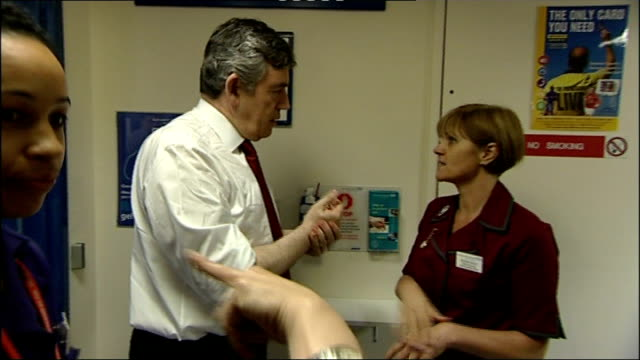 crewe and nantwich by-election: conservative victory; london: int gordon brown mp washing hands as chats with nurse on visit to hospital and talking... - ナントウィッチ点の映像素材/bロール