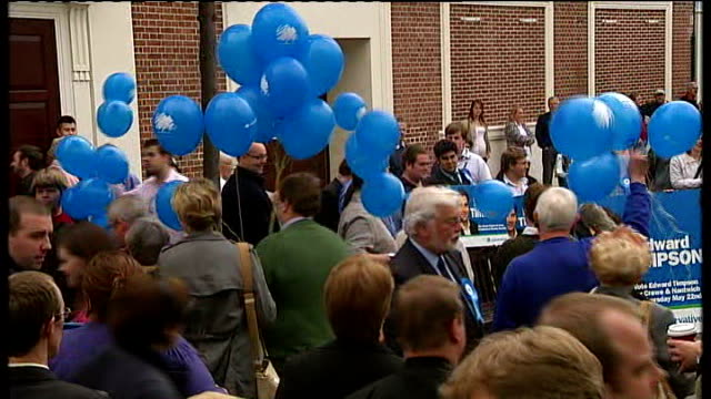 crewe and nantwich by-election: conservative victory; reporter tallking to eric pickles and conservative supporters milling around eric pickles mp... - nantwich stock-videos und b-roll-filmmaterial