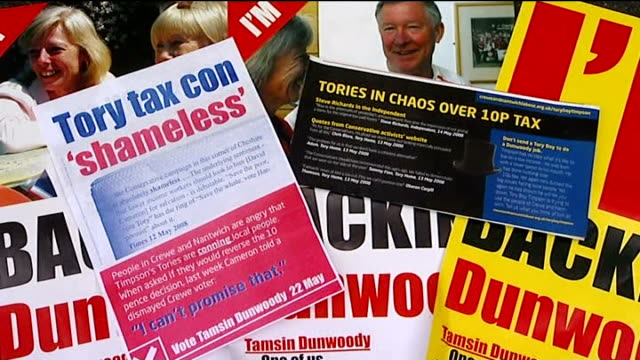 crewe and nantwich by-election; literature from labour campaign attacking conservatives - ナントウィッチ点の映像素材/bロール