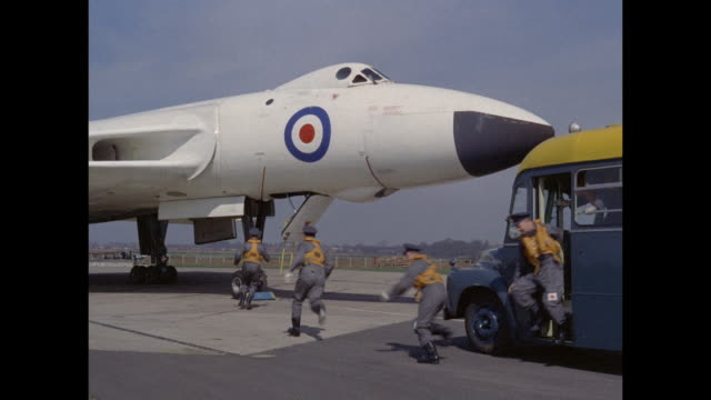 1959 raf crewmen scramble to their avro vulcan jet - supersonic airplane stock videos and b-roll footage