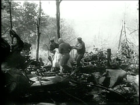 crews attempt to gather belongings of victims / smoldering forest following crash / narrated - narrating stock videos & royalty-free footage