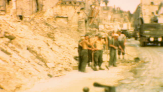 crews digging out rubble / views of slough / driving through destroyed commune / dday ruined commune on june 06 1944 in france - 礎石点の映像素材/bロール