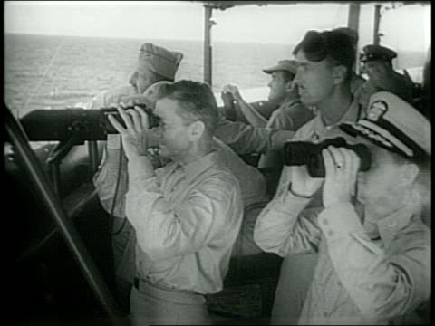 crews filming from plane / soldiers watch explosion / admiral blandy and secretary of the navy forrestall asses the explosion / close up view of... - nuclear weapon stock videos & royalty-free footage