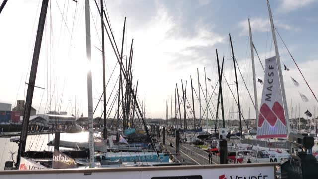 crews prepare boats that will set sail from les sables-d'olonne in france on sunday for the single-handed round-the-world yachting race despite a... - circumnavigation stock videos & royalty-free footage