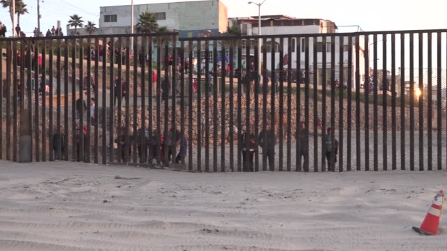 stockvideo's en b-roll-footage met crews prepare to install concertina wire on top of the border fence between the united states and mexico near border field state park the us army are... - san diego