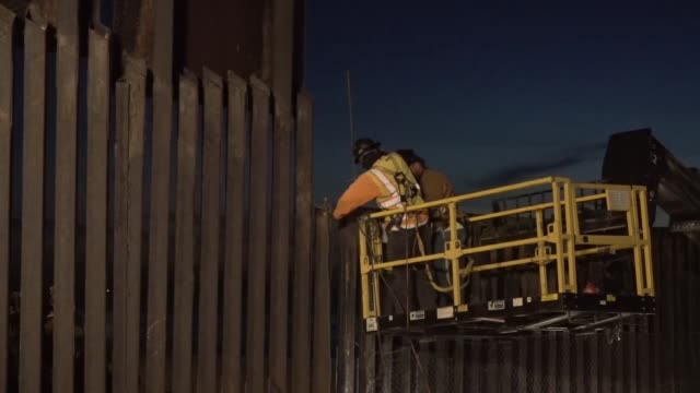 crews prepare to install concertina wire on top of the border fence between the united states and mexico near border field state park. the u.s. army... - us state border stock videos & royalty-free footage